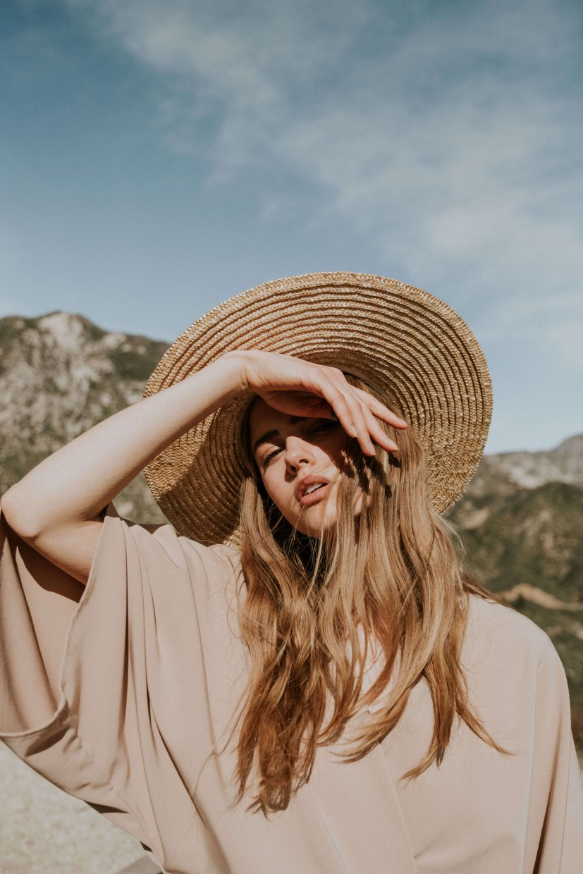 Girl shading her face from the sun in Los Angeles forest